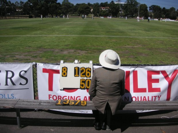 John Alcock watching the cricket