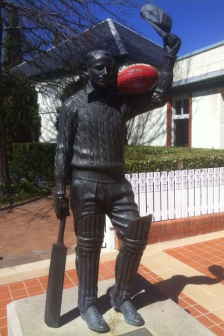 Photo of Bradman and football