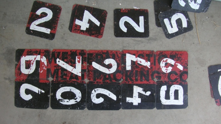 Home-made numbers and old advertising . And the red, black and white of the Birregurra Saints.