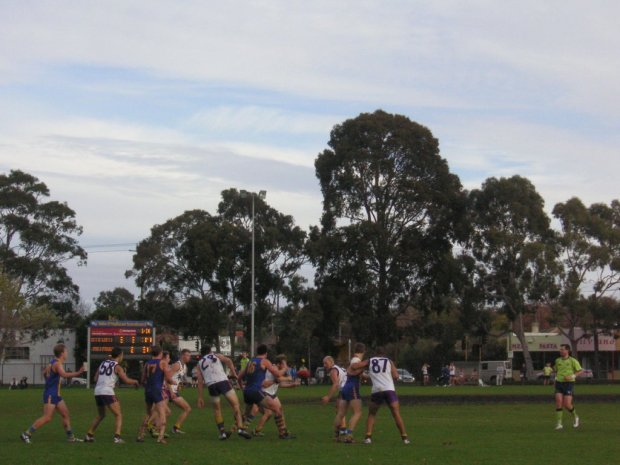 De La Salle (gold and blue), Collegians (white and purple) and a scoreboard that didn't take too kindly to my little camera.