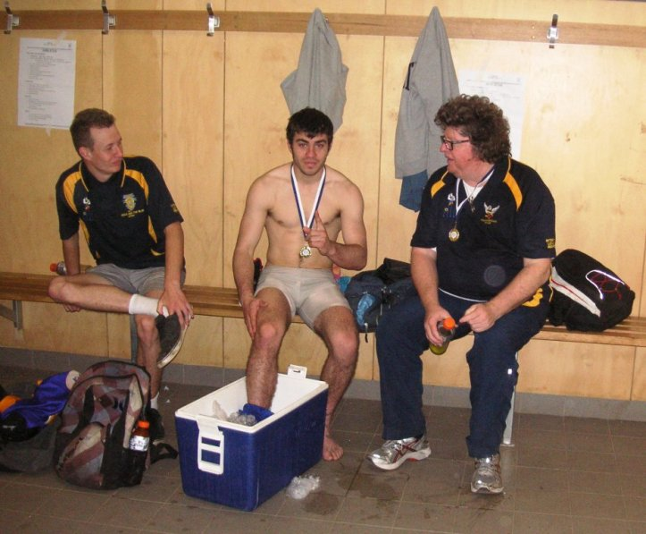 Williamstown premiership players Andrew Villiers and Kelvin O'Connor, with premiership coach Rob Klemm.