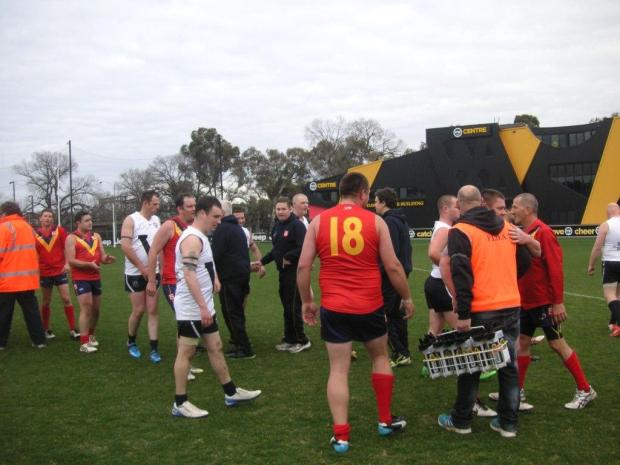 The spirit of the game, the spirit of FIDA footy: Vic Country and South Australian players shake hands (above) and unite arm-in-arm (below).