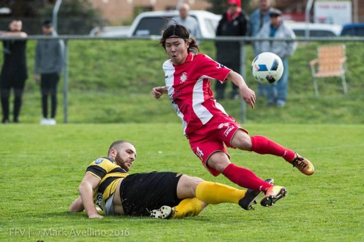 Yusei Kitade tackled by Steven Cudrig.